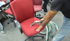 Steam extraction upholstery cleaning